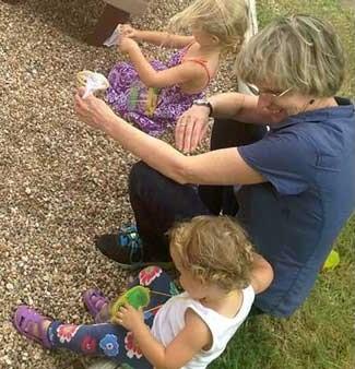 Sandy Blackard Listening to Children on Playground